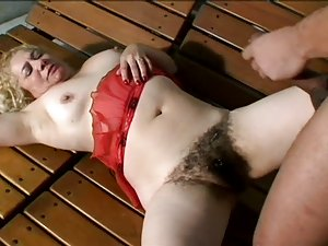 Busty Blonde Mature With a Thick Bush Sucks Cock and Then Gets Banged