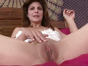 Brunette MILF Fucks Her Pussy with a Sex Toy in Lingerie